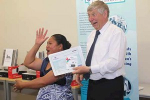 Fale Lio receiving her Graduation certificate.