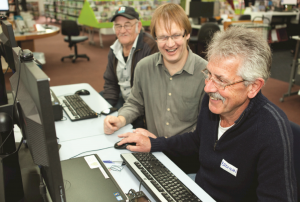 A participant is shown a trick on screen during a digital step session on Digital Photos at Blenheim Library.