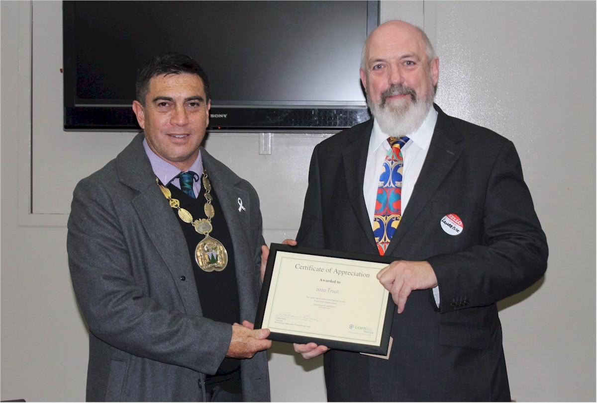 Laurence Millar receiving the certificate from Mayor of Porirua Mike Tana